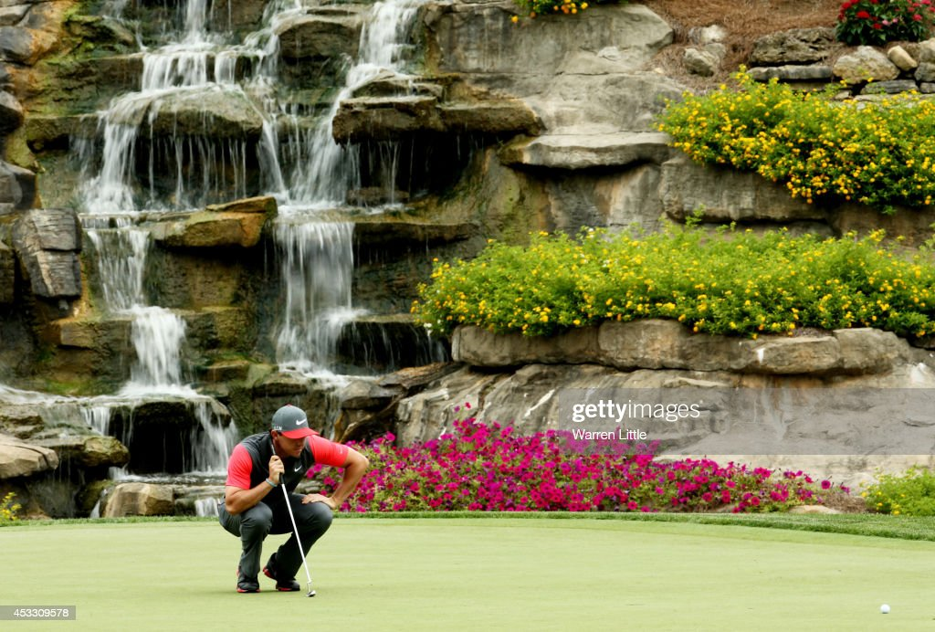 Rory McIlroy of Northern Ireland lines up his putt on the 13th green during the first round of the 96th PGA Championship at Valhalla Golf Club on August 7, 2014 in Louisville, Kentucky.