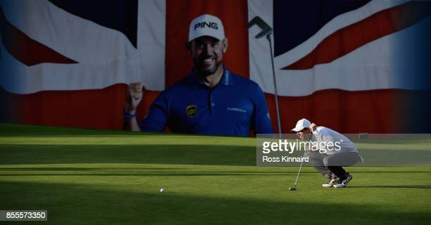 Rory McIlroy of Northern Ireland lines up his putt on the 18th green during the second round of the British Masters at Close House Golf Club on...
