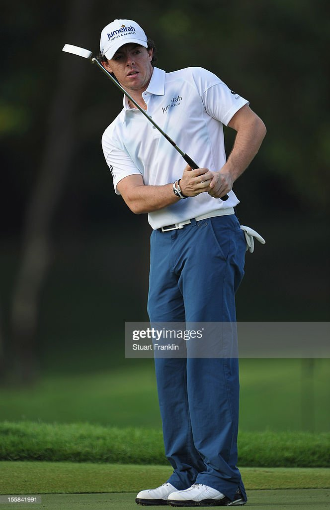 Rory McIlroy of Northern Ireland looks at his putt during the continuation of the weather delayed first round of the Barclays Singapore Open at the Sentosa Golf Club on November 9, 2012 in Singapore.