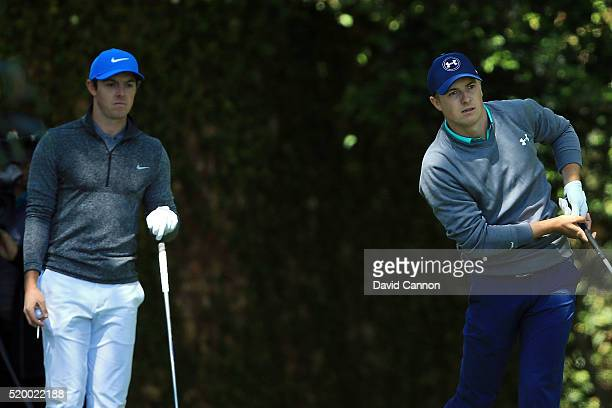 Rory McIlroy of Northern Ireland looks on as Jordan Spieth of the United States plays his shot from the second tee during the third round of the 2016...