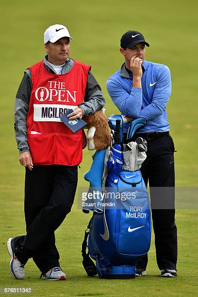 Rory McIlroy of Northern Ireland looks on next to his caddie JP Fitzgerald at the 10th during the second round on day two of the 145th Open...