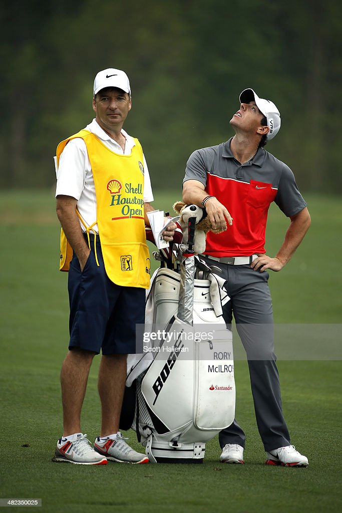 Rory McIlroy (R) of Northern Ireland looks up with his caddy J.P. Fitzgerald (L) on the second hole during round one of the Shell Houston Open at the Golf Club of Houston on April 3, 2014 in Humble, Texas.