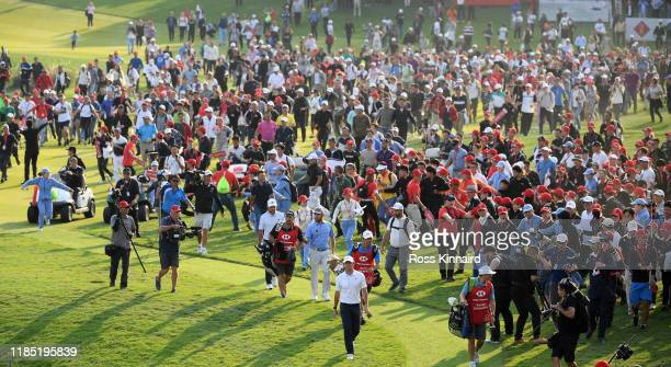 Rory McIlroy of Northern Ireland makes his way on to the 18th green during the final round of the WGC HSBC Champions at Sheshan International Golf...