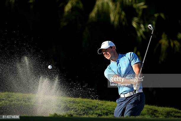 Rory McIlroy of Northern Ireland out of the bunker on the 13th hole during the final round of the World Golf ChampionshipsCadillac Championship at...