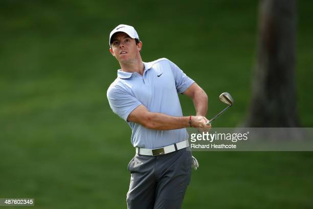 Rory McIlroy of Northern Ireland pitches into the 15th green during the first round of the Wells Fargo Championship at the Quail Hollow Club on May 1...