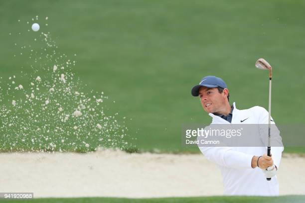 Rory McIlroy of Northern Ireland plays a bunker shot during a practice round prior to the start of the 2018 Masters Tournament at Augusta National...