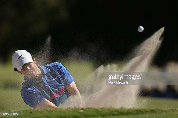 Rory McIlroy of Northern Ireland plays a bunker shot on the 16th hole during day four of the 2013 Australian Open at Royal Sydney Golf Club on...