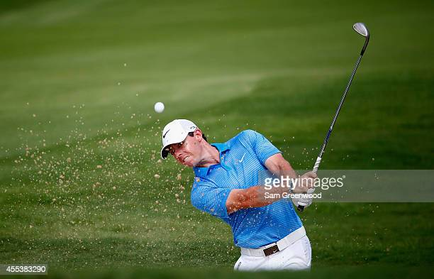 Rory McIlroy of Northern Ireland plays a bunker shot on the seventh hole during the third round of the TOUR Championship by CocaCola at the East Lake...