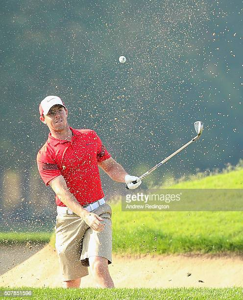 Rory McIlroy of Northern Ireland plays a bunker shot on the sixth hole during practice for the 2016 Omega Dubai Desert Classic on the Majlis Course...