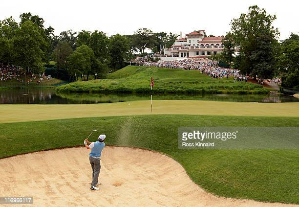 Rory McIlroy of Northern Ireland plays a bunker shot on the tenth hole during the third round of the 111th US Open at Congressional Country Club on...