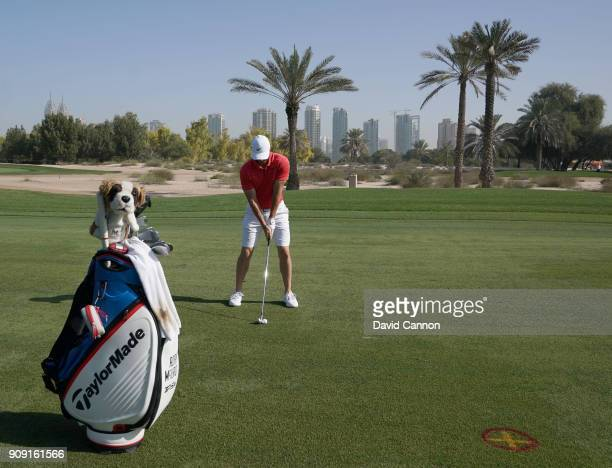 Rory McIlroy of Northern Ireland plays a long iron shot as a preview for the Omega Dubai Desert Classic on the Majlis Course at The Emirates Golf...
