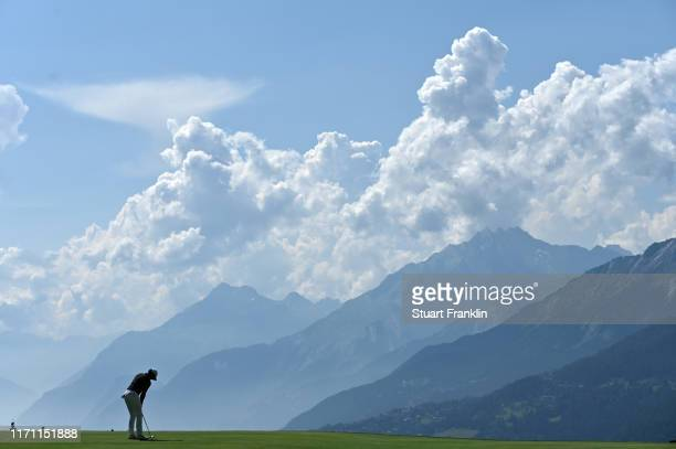 Rory McIlroy of Northern Ireland plays a putt the 7th hole during Day Two of the Omega European Masters at CranssurSierre Golf Club on August 30 2019...