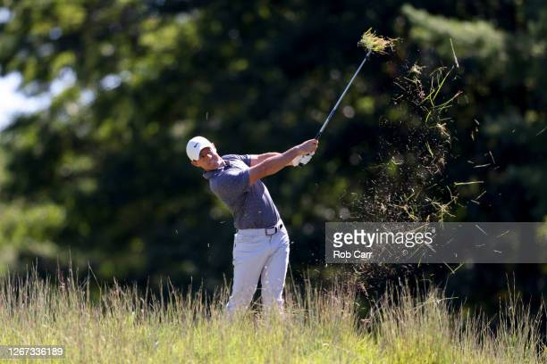 Rory McIlroy of Northern Ireland plays a second shot on the 17th hole during the first round of The Northern Trust at TPC Boston on August 20, 2020...