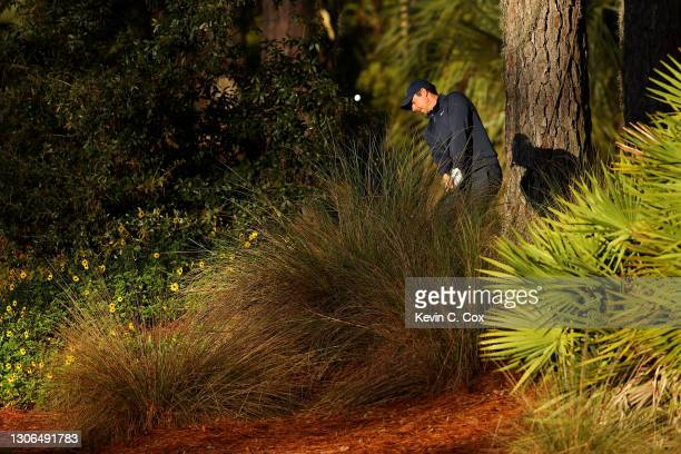 Rory McIlroy of Northern Ireland plays a shot after taking a drop on the tenth hole during the first round of THE PLAYERS Championship on THE PLAYERS...