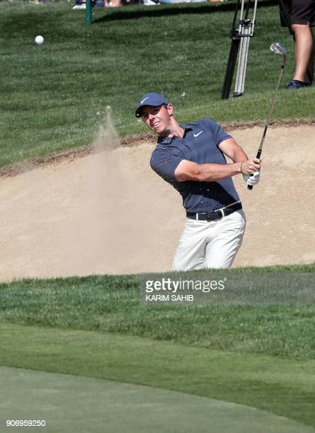 Rory McIlroy of Northern Ireland plays a shot during round two of the Abu Dhabi HSBC Golf Championship at Abu Dhabi Golf Club on January 19 2018 /...