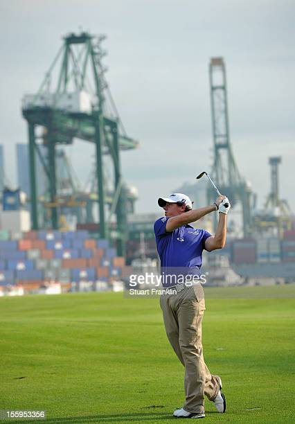 Rory McIlroy of Northern Ireland plays a shot during the resumption of the rain delayed second round of the Barclays Singapore Open at the Sentosa...