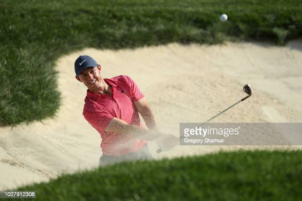 Rory McIlroy of Northern Ireland plays a shot from a bunker on the seventh hole during the first round of the BMW Championship at Aronimink Golf Club...
