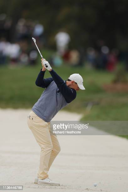 Rory McIlroy of Northern Ireland plays a shot from a bunker on the 15th hole during the final round of The PLAYERS Championship on The Stadium Course...