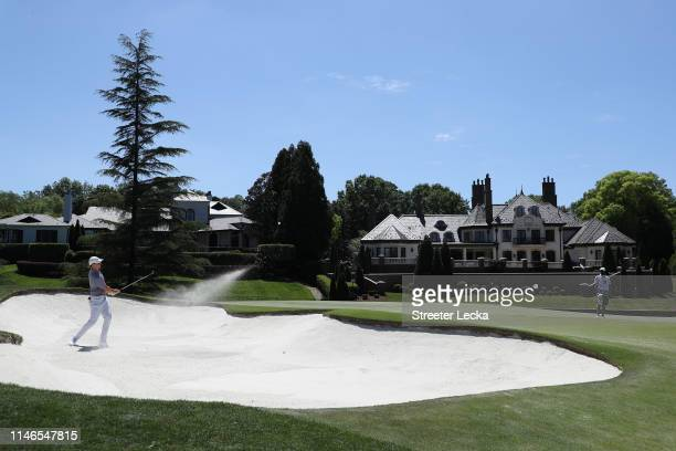 Rory McIlroy of Northern Ireland plays a shot from a bunker on the seventh hole during the first round of the 2019 Wells Fargo Championship at Quail...