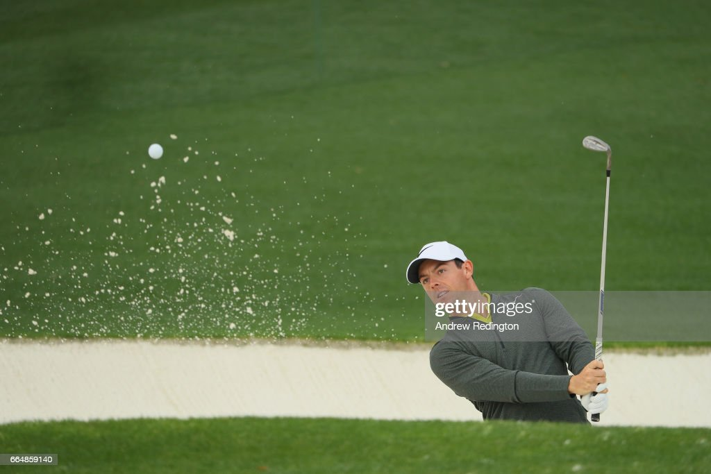 Rory McIlroy of Northern Ireland plays a shot from a bunker on the 18th hole during a practice round prior to the start of the 2017 Masters Tournament at Augusta National Golf Club on April 5, 2017 in Augusta, Georgia.