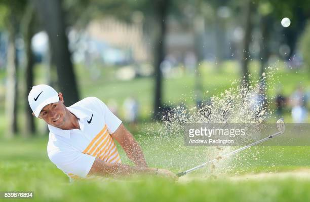 Rory McIlroy of Northern Ireland plays a shot from a bunker on the first hole during the final round of The Northern Trust at Glen Oaks Club on...