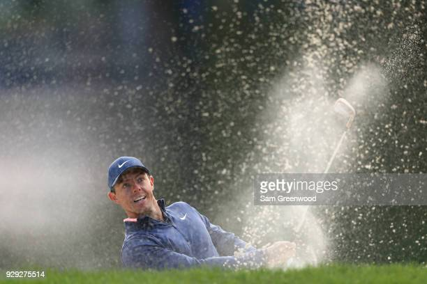 Rory McIlroy of Northern Ireland plays a shot from a bunker on the 12th hole during the first round of the Valspar Championship at Innisbrook Resort...