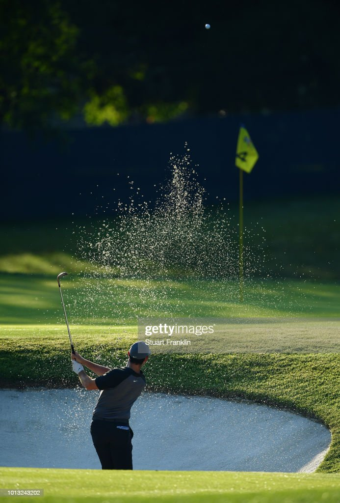 Rory McIlroy of Northern Ireland plays a shot from a greenside bunker during a practice round prior to the 2018 PGA Championship at Bellerive Country Club on August 8, 2018 in St Louis, Missouri.