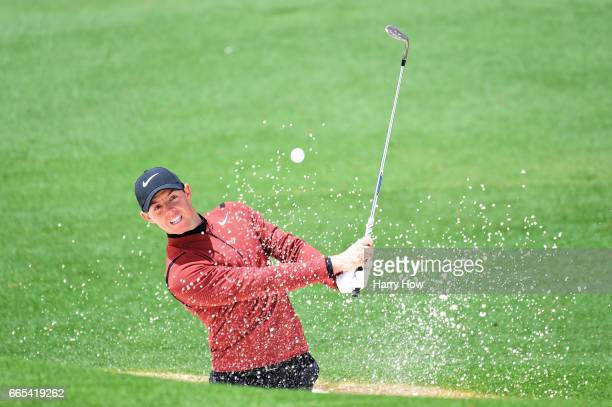 Rory McIlroy of Northern Ireland plays a shot from a greenside bunker on the second hole during the first round of the 2017 Masters Tournament at...