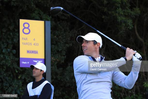 Rory McIlroy of Northern Ireland plays a shot from the eighth tee where a special tee marker is being used remembering Kobe Bryant during the proam...