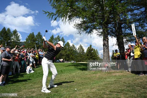 Rory McIlroy of Northern Ireland plays a shot from the rough on the 9th hole during Day Two of the Omega European Masters at CranssurSierre Golf Club...