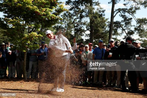 Rory McIlroy of Northern Ireland plays a shot from the rough on the eighth hole during the final round of the 2018 Masters Tournament at Augusta...