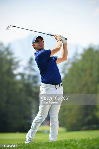 Rory McIlroy of Northern ireland plays a shot in practice prior to the start of the Omega European Masters at Crans Montana Golf Club on August 27,...