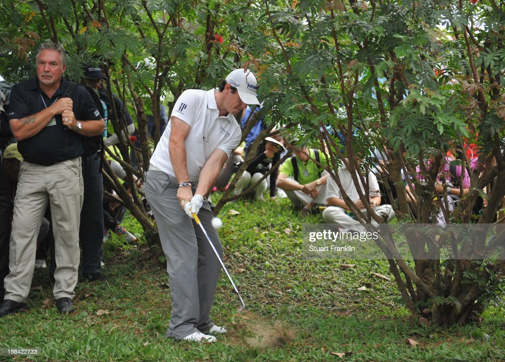 Rory McIlroy of Northern Ireland plays a shot left handed from a bush on the sixth hole during the first round of the UBS Hong Kong open at The Hong Kong Golf Club on November 15, 2012 in Hong Kong, Hong Kong.