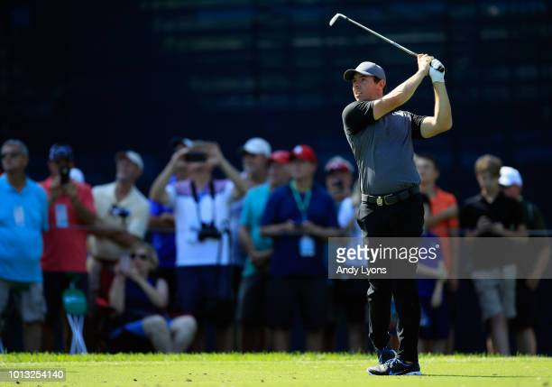Rory McIlroy of Northern Ireland plays a shot on the 12th hole during a practice round prior to the 2018 PGA Championship at Bellerive Country Club...