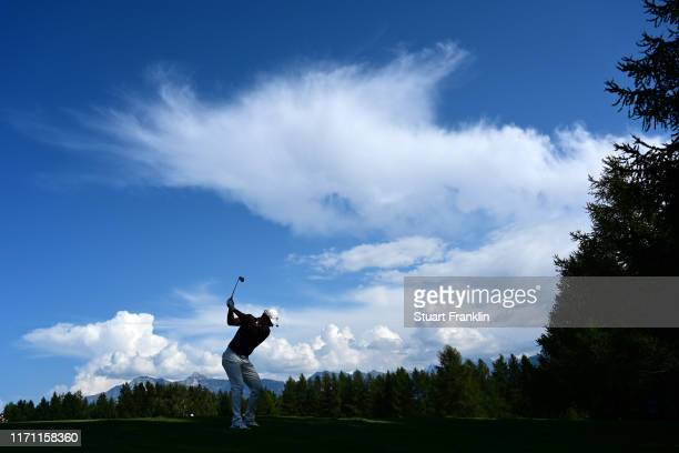 Rory McIlroy of Northern Ireland plays a shot on the 12th hole during Day Two of the Omega European Masters at CranssurSierre Golf Club on August 30...