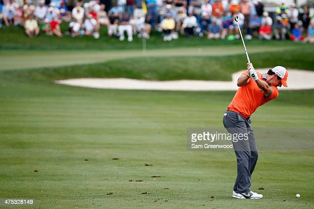 Rory McIlroy of Northern Ireland plays a shot on the 12th hole during the first round of The Honda Classic at PGA National Resort and Spa on February...