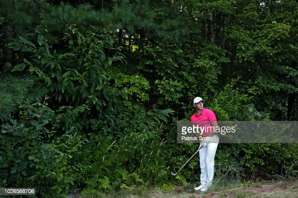 Rory McIlroy of Northern Ireland plays a shot on the 14th hole during the final round of the Dell Technologies Championship at TPC Boston on...