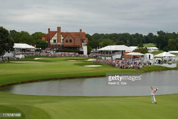 Rory McIlroy of Northern Ireland plays a shot on the 18th hole during the final round of the TOUR Championship at East Lake Golf Club on August 25,...