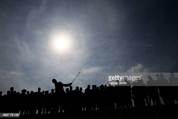 Rory McIlroy of Northern Ireland plays a shot on the 18th hole during the First Round of the BMW Championship at Conway Farms Golf Club on September...