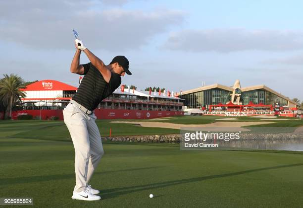 Rory McIlroy of Northern Ireland plays a shot on the 18th hole during the pro-am for the 2018 Abu Dhabi HSBC Golf Championship at the Abu Dhabi Golf...