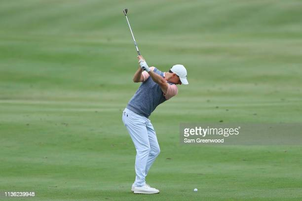Rory McIlroy of Northern Ireland plays a shot on the ninth hole during the third round of The PLAYERS Championship on The Stadium Course at TPC...