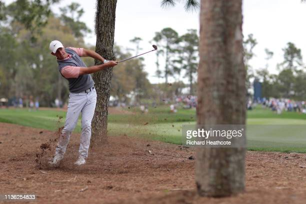 Rory McIlroy of Northern Ireland plays a shot on the sixth hole during the third round of The PLAYERS Championship on The Stadium Course at TPC...