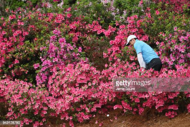 Rory McIlroy of Northern Ireland plays a shot out of the flowers on the 13th hole during the third round of the 2018 Masters Tournament at Augusta...