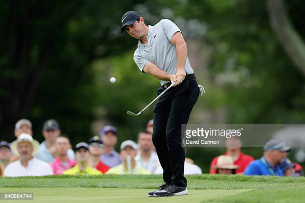 Rory McIlroy of Northern Ireland plays a shot with a wedge on the fourth green during the first round of the US Open at Oakmont Country Club on June...