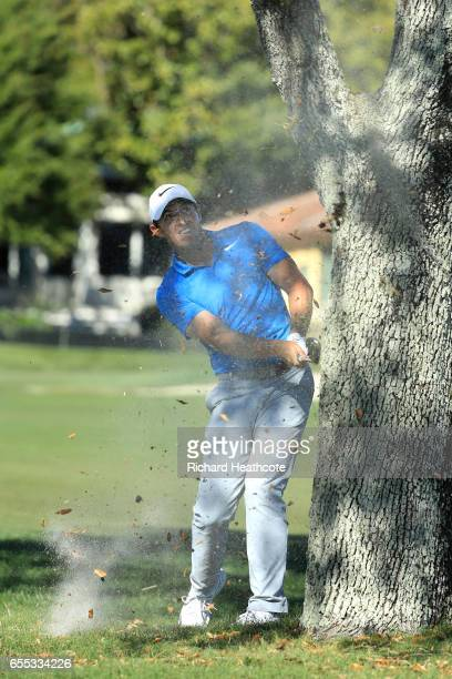 Rory McIlroy of Northern Ireland plays around a tree trunk on the 16th during the final round of the Arnold Palmer Invitational Presented By...
