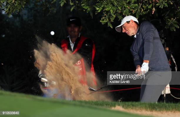 Rory McIlroy of Northern Ireland plays during round one of the Abu Dhabi HSBC Golf Championship at Abu Dhabi Golf Club on January 18 2018 / AFP PHOTO...