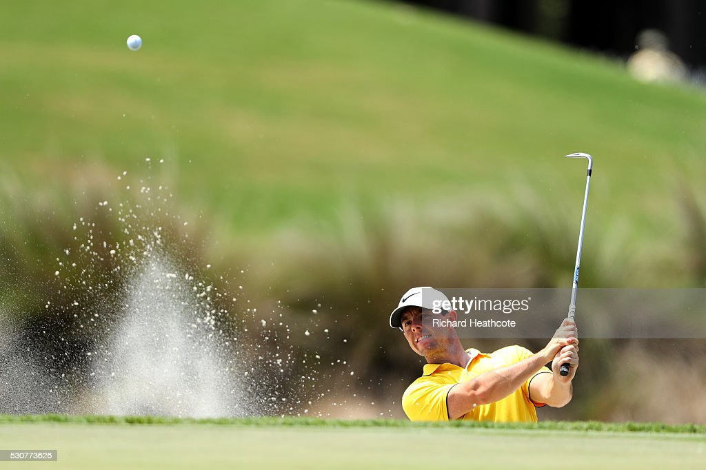 Rory McIlroy of Northern Ireland plays from a bunker during a practise round for THE PLAYERS Championship on The Stadium Course at TPC Sawgrass on May 11, 2016 in Ponte Vedra Beach, Florida.