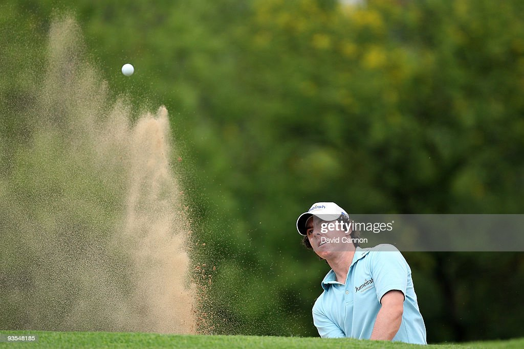Rory McIlroy of Northern Ireland plays from sand at the 10th hole during the pro-am as a preview for the 2009 Nedbank Golf Challenge at the Gary Player Country Club Course on December 2, 2009 in Sun City, South Africa.