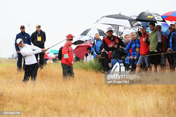 Rory McIlroy of Northern Ireland plays from the rough on the 6th hole during round two of the Open Championship at Carnoustie Golf Club on July 20...