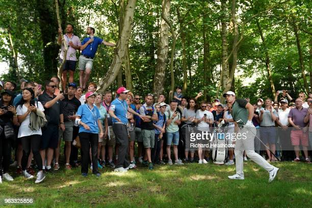 Rory McIlroy of Northern Ireland plays from under the trees on the third hole during the third round of the BMW PGA Championship at Wentworth on May...